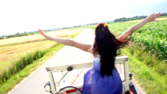 HD SUPER SLOW-MOTION: Woman Holding Her Arms Up In Convertible