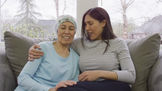 woman holding her mother who is recovering from cancer - scarf stock videos & royalty-free footage