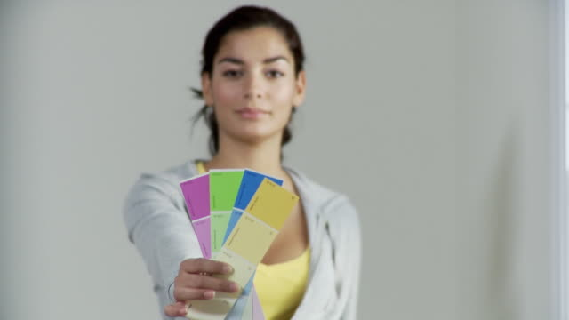 CU, R/F, Woman holding paint swatches, Plainfield, New Jersey, USA