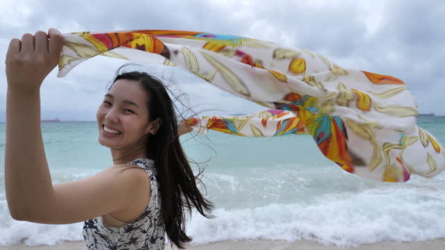 Woman Holding Scarf In Wind, Sea