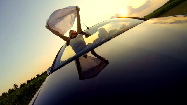 hd slow motion: woman holding sheet on open road - convertible stock videos & royalty-free footage