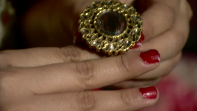 a woman holds a ring and places it on her finger. - ring stock videos & royalty-free footage