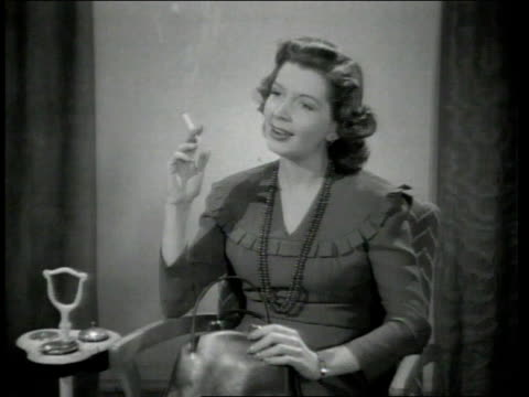1942 montage woman holds cigarette in hand for a moment before extinguishing it in ashtray - extinguishing stock videos and b-roll footage