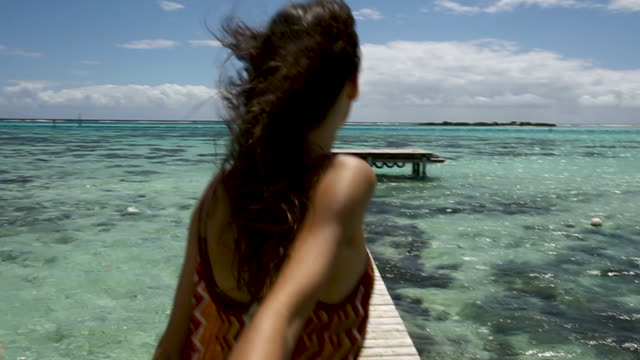 woman holds hands while walking on tahiti dock, point of view - pacific islands stock videos & royalty-free footage