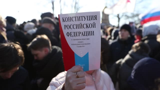 woman holds russian constitution during a rally in a memory of russian opposition politic boris nemtsov, at trinity square on febuary 29, 2019 in... - constitution stock videos & royalty-free footage