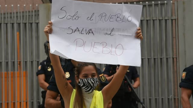 woman holds up a sign during a demonstration, in the vallecas neighborhood, against the measures imposed by the capital's regional government to... - number 2 stock videos & royalty-free footage