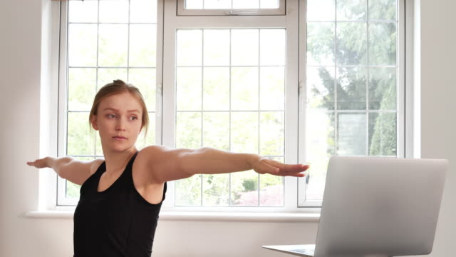 woman home yoga class - prayer position stock videos & royalty-free footage