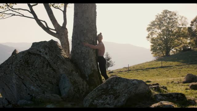 woman hugging big tree - tree hugging stock videos & royalty-free footage