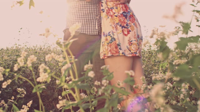 SLO MO Woman hugging her loving in buckwheat field