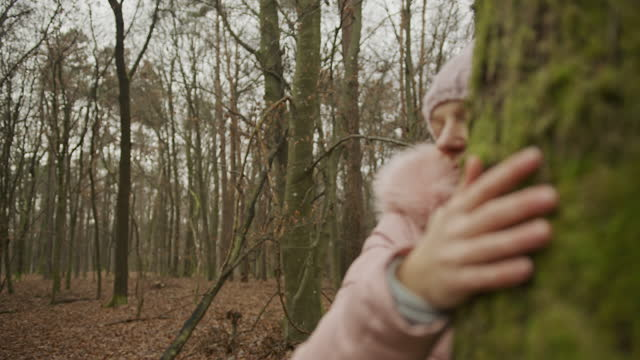 woman hugging tree in forest - tree hugging stock videos & royalty-free footage