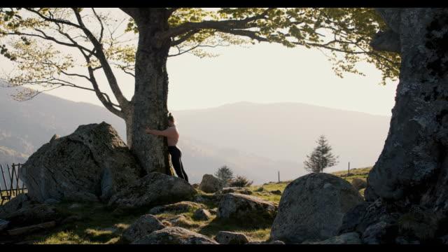 woman hugging tree - tree hugging stock videos & royalty-free footage