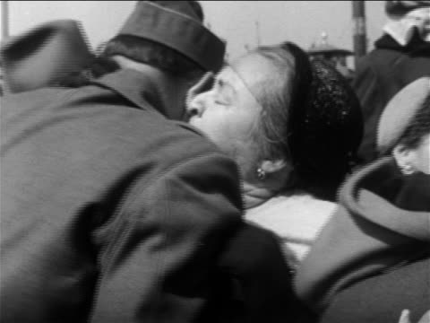 b/w 1953 woman hugging us soldier in midst of welcome crowd / end of korean war / newsreel - 1953 stock videos and b-roll footage