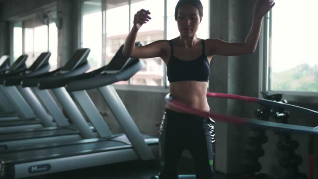 woman hula-hooping at gym - plastic hoop stock videos & royalty-free footage