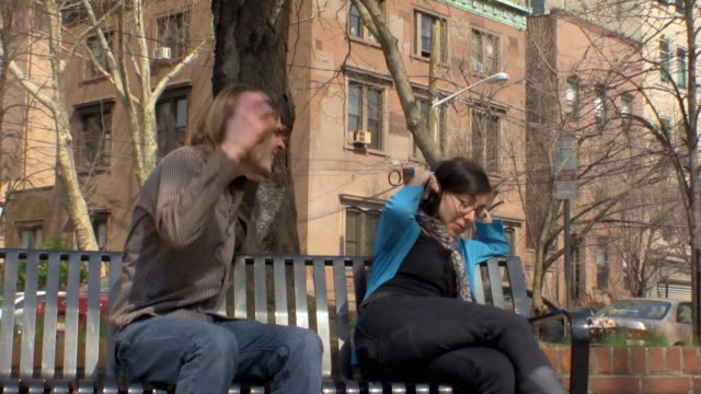 stockvideo's en b-roll-footage met ws zi zo woman ignoring man and listening to her mp3 player / jersey city, new jersey, usa - communication problems