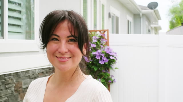 woman in a backyard garden - beautiful woman stock videos & royalty-free footage