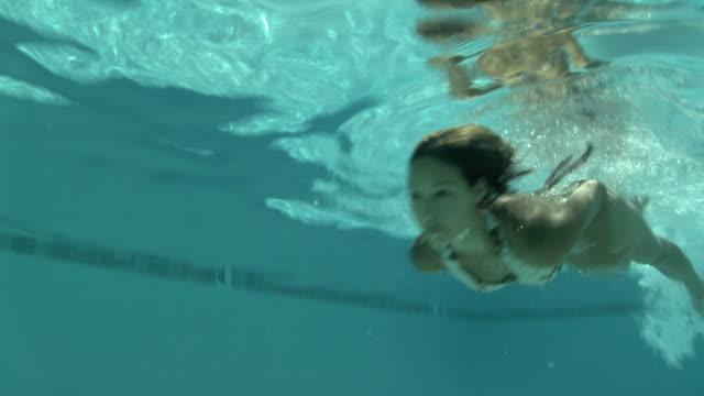 woman in a bikini swimming in a pool - filipino ethnicity stock videos and b-roll footage