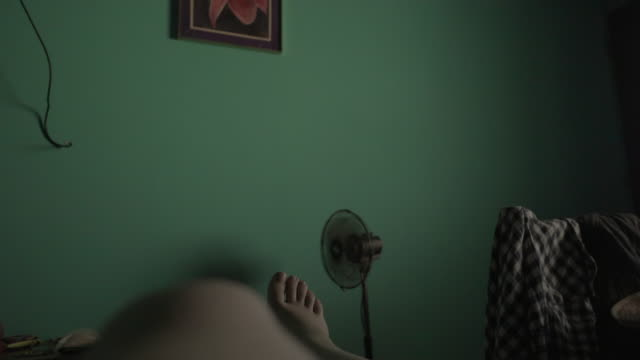 pov woman in a cheap hostel room having a nap with the electric fan turned on. - bedroom stock videos & royalty-free footage