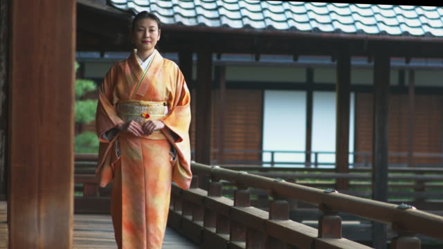 woman in a kimono walking through a temple - indigenous culture stock videos & royalty-free footage