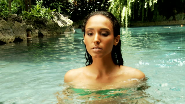 Woman in a natural pool