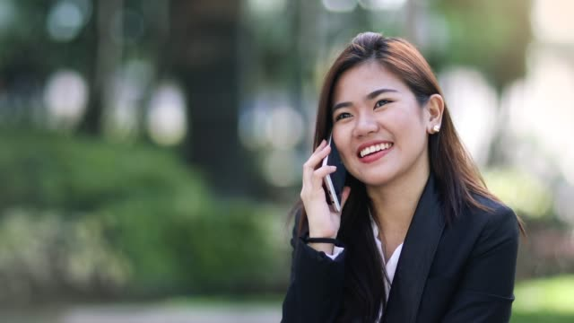 woman in a phone conversation - filippine video stock e b–roll