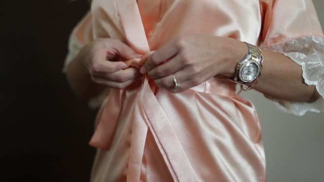 a woman in a silk robe - bathrobe stock videos & royalty-free footage