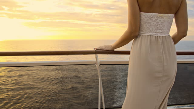 slo mo woman in a summer dress on the ship - safety rail stock videos & royalty-free footage