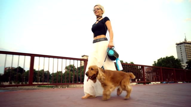 Woman in a walk with her puppy