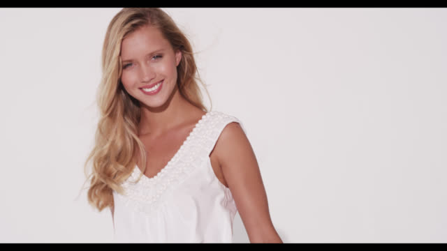 a woman in a white dress smiles - urbanlip stock videos & royalty-free footage