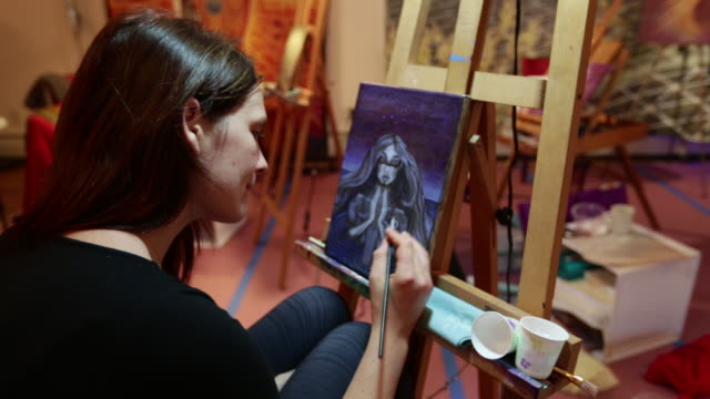 Woman in Alex grey Painting Workshop