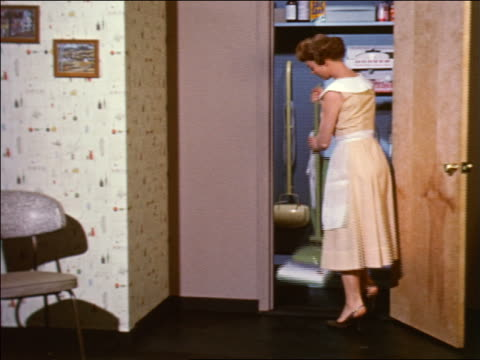 1959 woman in apron putting vacuum cleaner in closet + closing door / industrial - prelinger archive stock videos & royalty-free footage
