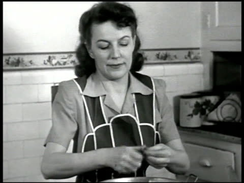 woman in apron stringing beans cooking listening to radio cu radio 'more violence amp bloodshed'' ms woman changing station cu radio dial vs woman... - stereotypical housewife stock videos & royalty-free footage