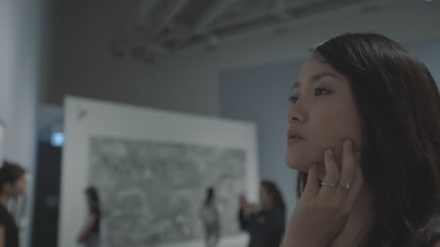 woman in art gallery - exhibition stock videos & royalty-free footage