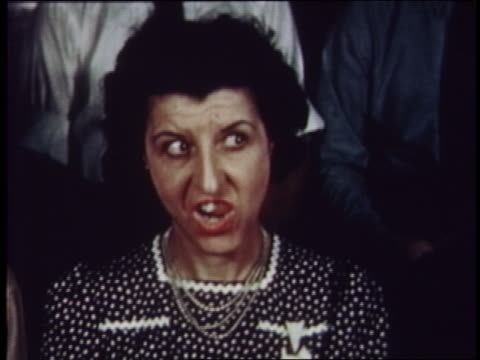 1954 woman in audience moving her tongue about in mouth - 1954 bildbanksvideor och videomaterial från bakom kulisserna