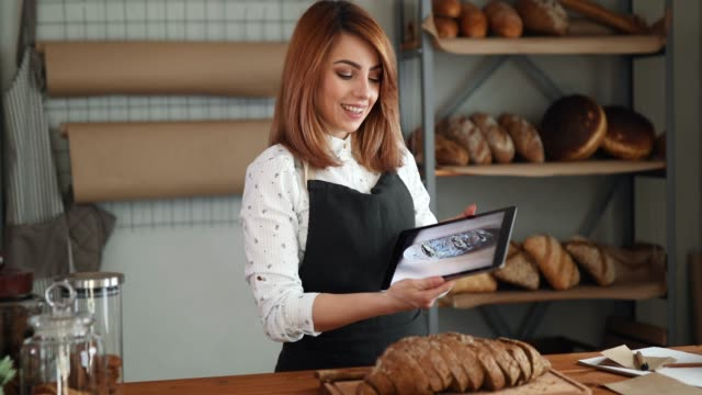 woman in bakery using tablet - selling stock videos & royalty-free footage