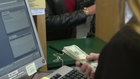 vídeos de stock e filmes b-roll de cu tu woman in bank making withdrawal and talking on phone, bethlehem, pennsylvania, usa - making money