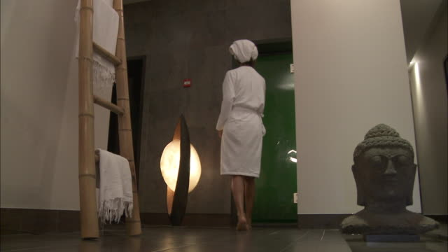 ws woman in bathrobe entering sauna / bruxelles city, bruxelles, belgium - sauna stock videos and b-roll footage