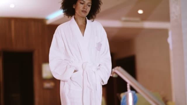 woman in bathrobe standing at poolside - bathrobe stock videos & royalty-free footage