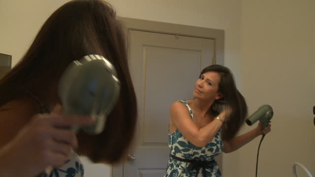 ms woman in bathroom drying long hair with blow dryer, austin, texas, usa - drying stock videos & royalty-free footage