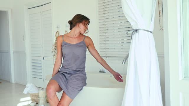 vídeos y material grabado en eventos de stock de woman in bathroom, man walking in - camisola
