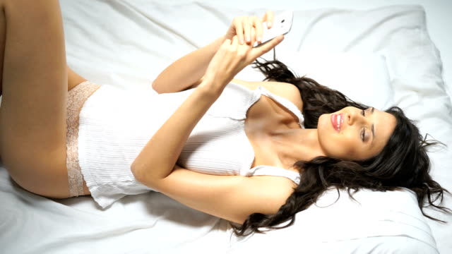 woman in bed sending text msg - doll stock videos and b-roll footage