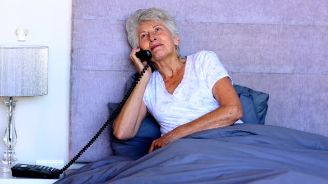 woman in bed talking on the phone - hanging up stock videos and b-roll footage