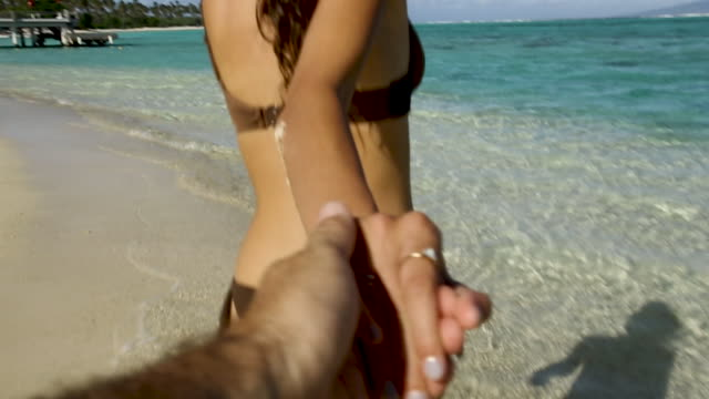 woman in bikini hold hands on tahiti beach, point of view - french polynesia stock videos & royalty-free footage