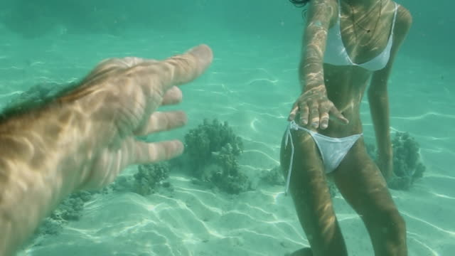 woman in bikini holds hands underwater, point of view - french overseas territory stock videos & royalty-free footage