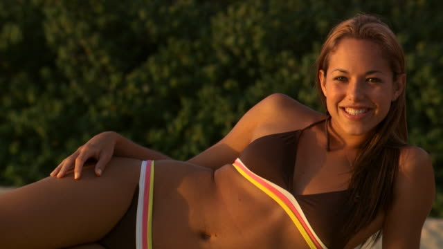 woman in bikini lying down outdoors smiling - see other clips from this shoot 1142 stock videos & royalty-free footage
