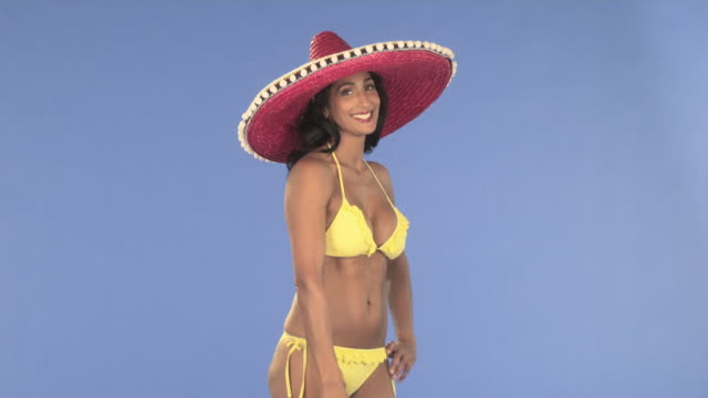 woman in bikini with sombrero and suitcase - sombrero stock videos & royalty-free footage