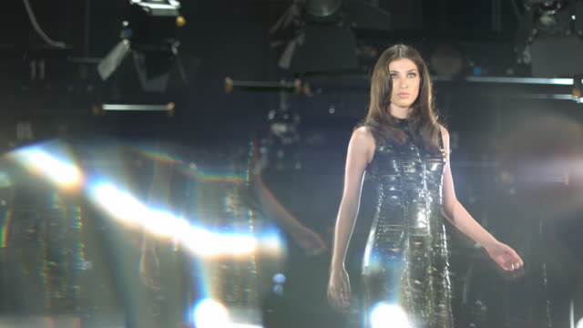 woman in black dress walking back and forth on a catwalk. - glamour stock videos & royalty-free footage