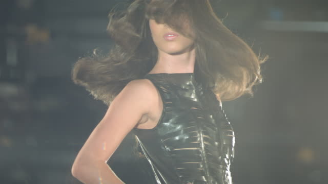 woman in black dress walking on a catwalk tossing her hair. - glamour stock videos & royalty-free footage
