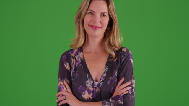 stockvideo's en b-roll-footage met woman in blouse standing in park in autumn, smiling at camera on green screen - blouse