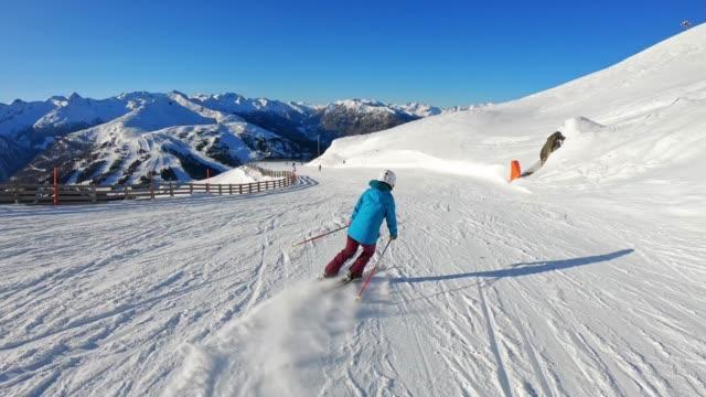 woman in blue ski jacket skiing down the ski slope - ski jacket stock videos & royalty-free footage