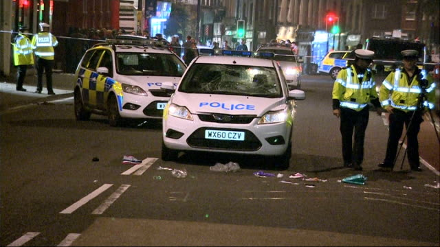 woman in bristol seriously injured after being hit by police car england bristol varuious of police officers and police cars in cordonedoff road... - croft stock videos & royalty-free footage